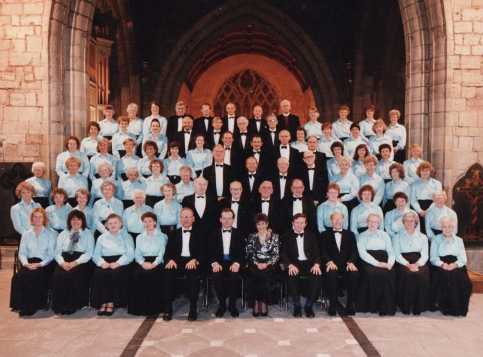 Choir with conductor Hugh Davies